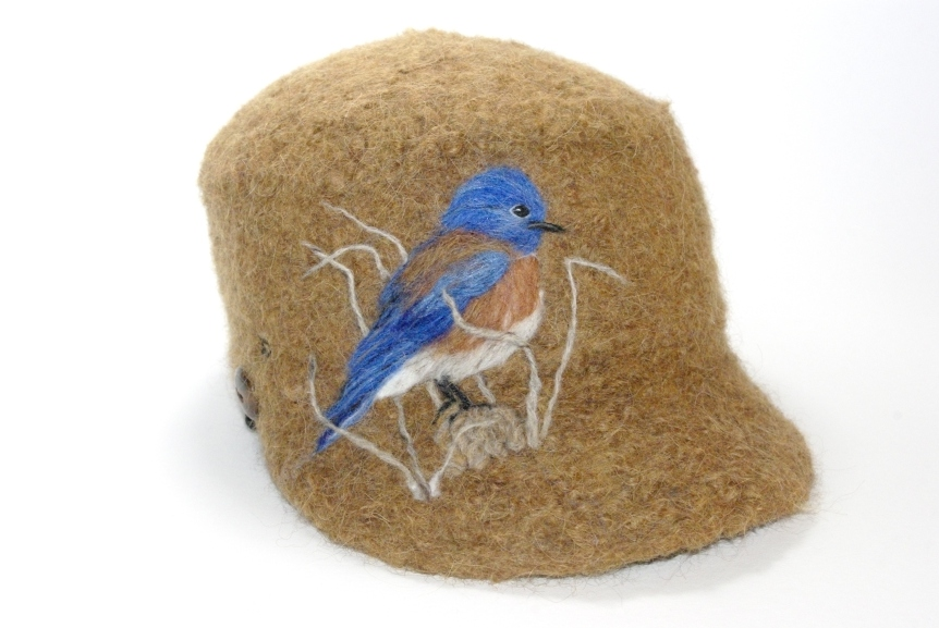 14-013 cap bluebird on rust pastaza llama wool sold to Gary Slater $80 for Eco Institute auction